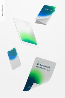 Artigos de papelaria com maquete de dispositivos flutuantes