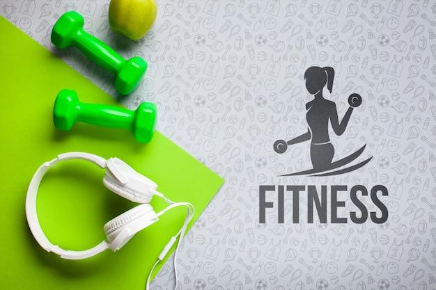 Auscultadores e pesos para a aula de fitness