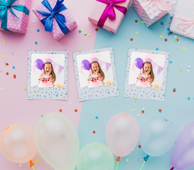 Balões coloridos com confetes e fotos