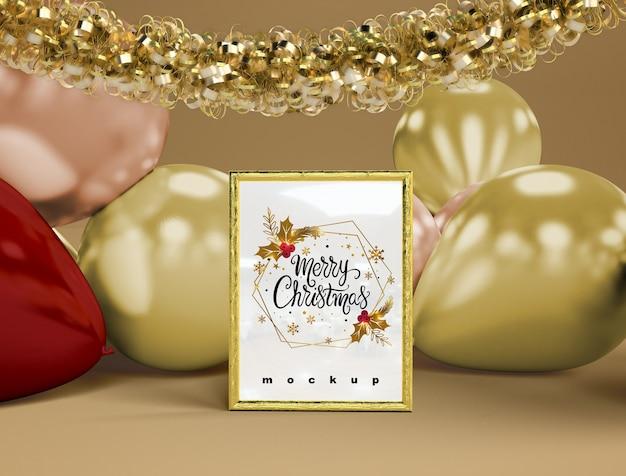Balões com maquete de natal