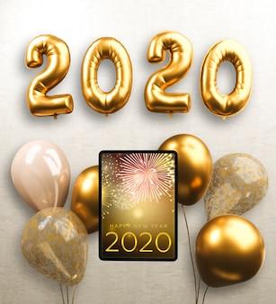Balões e tablet para o ano novo