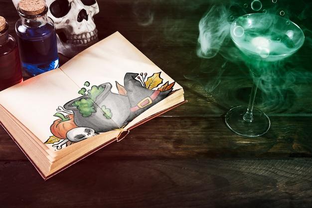 Bebida venenosa e livro aberto com desenho de halloween