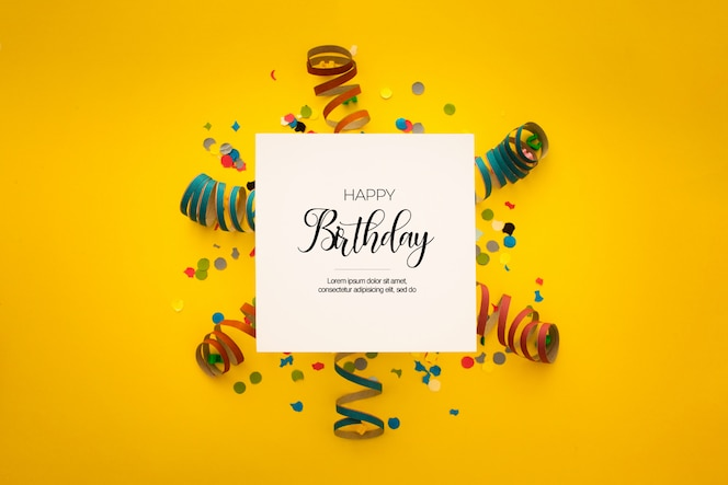 Bela composição de aniversário com confete amarelo