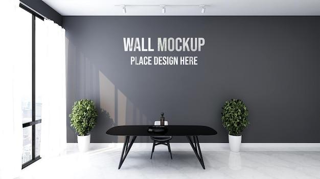 Bela maquete de parede na parede preta do espaço de trabalho