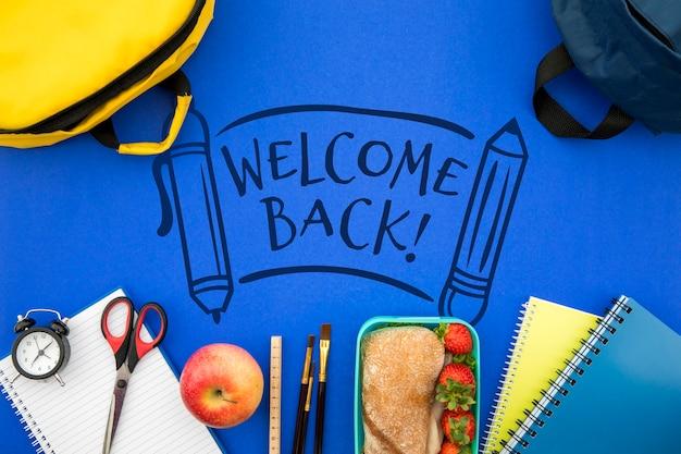 Bem-vindo de volta à escola, mochila com material de estudante
