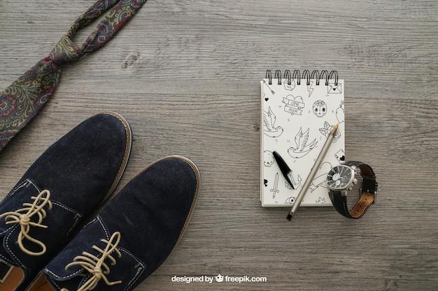 Bloco de notas com sapatos e gravata