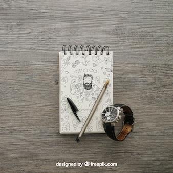 Bloco de notas e relógio