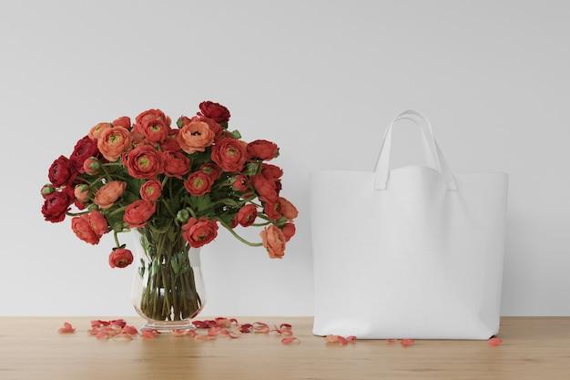 Bolsa branca e flores em um vaso