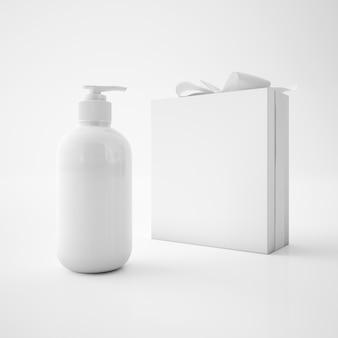Caixa branca com fita e recipiente de sabão