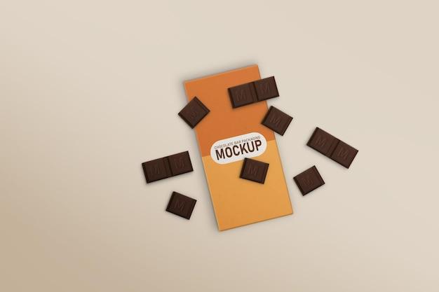 Caixa de barra de chocolate com maquete de chocolates espalhados