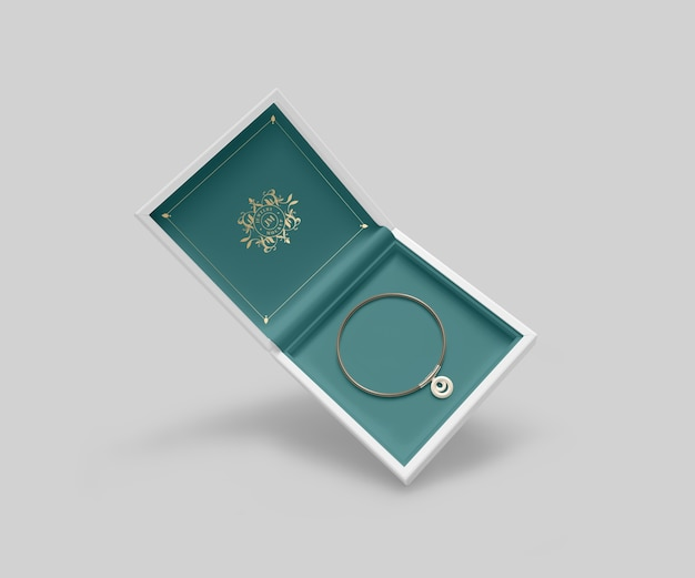 Caixa de joias com pulseira dourada e símbolo