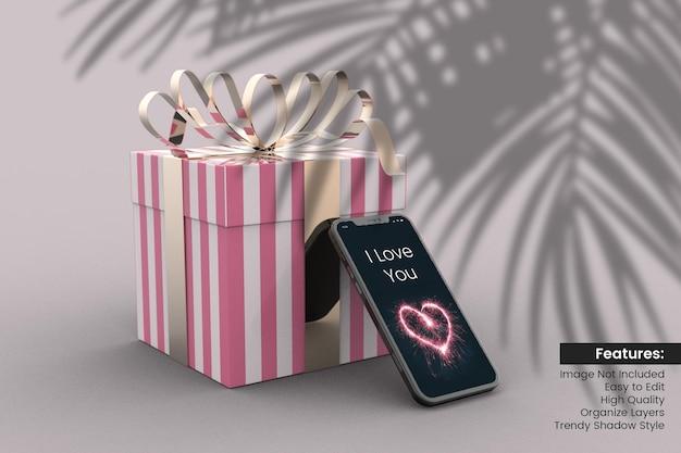 Caixa de presente 3d do dia dos namorados com maquete de smartphone