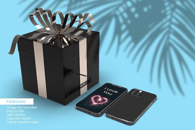 Caixa de presente de dia dos namorados com renderização em 3d em preto e maquete de smartphone