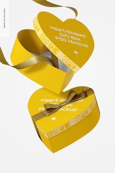 Caixa de presente em forma de coração com maquete de fita de papel flutuante