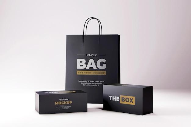 Caixa de sapatos e maquete de sacola de compras preto realista