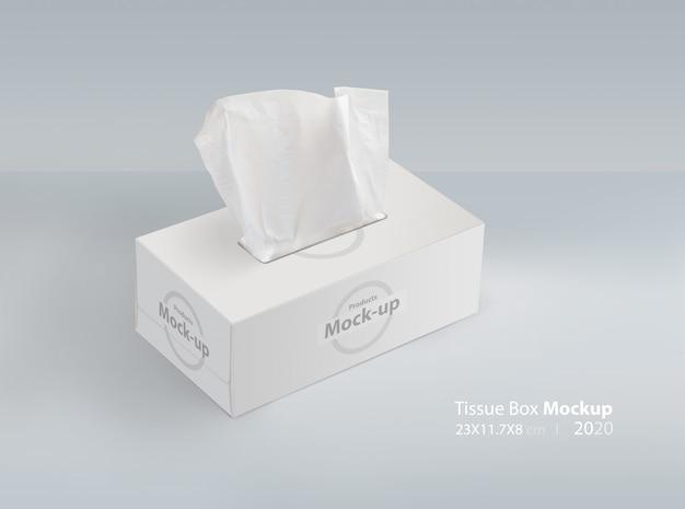 Caixa de tecidos em fundo cinza claro com tecido facial