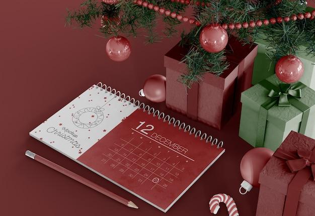 Calendário com maquete de enfeites de natal Psd Premium