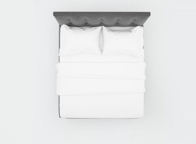 Cama com lençóis brancos