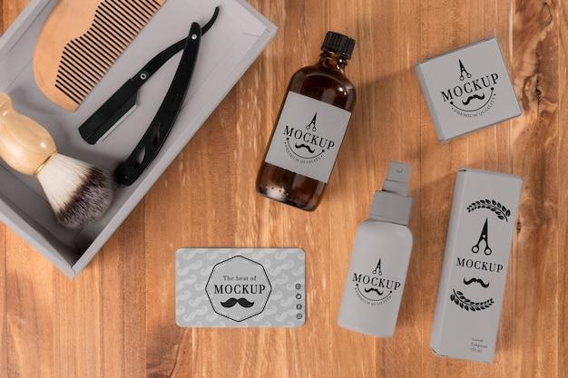 Camada plana de produtos de barbearia com lâmina e escova