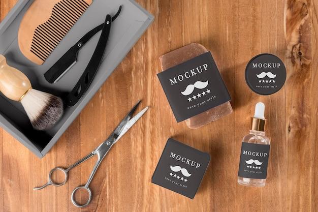 Camada plana de produtos de barbearia com tesoura e soro