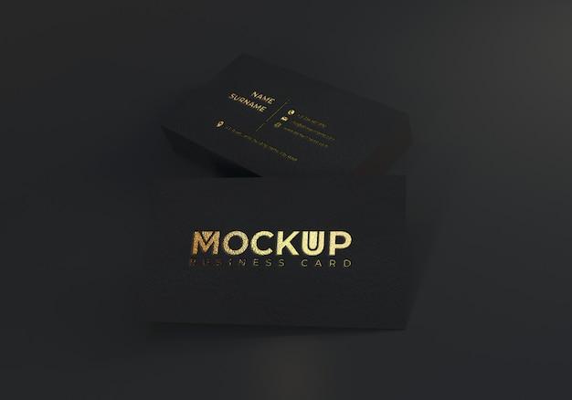 Carta imprensa ouro cartão de visita maquete no papel texturizado preto