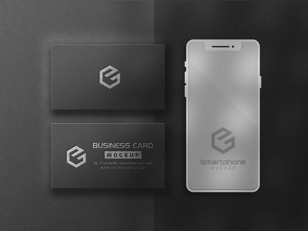 Cartão de visita e maquete de smartphone com fundo preto