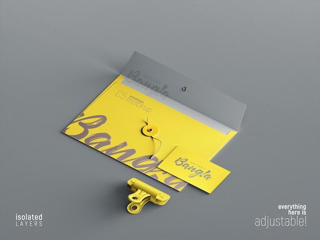 Cartão de visita e modelo de envelope c5 com vista em perspectiva de clipe de papel