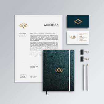 Cartão de visita, papel timbrado e notebook maquete