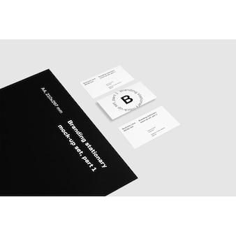 Cartões de visita ao lado de pasta preta mock up
