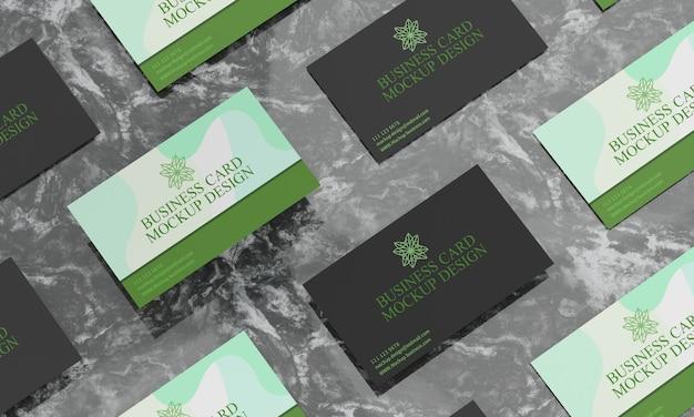 Cartões de visita em maquete de mesa de mármore preto