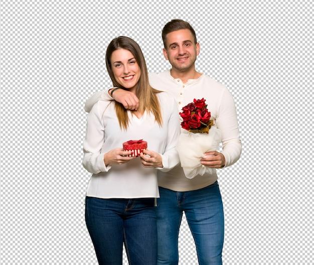 Casal no dia dos namorados com flores e presentes