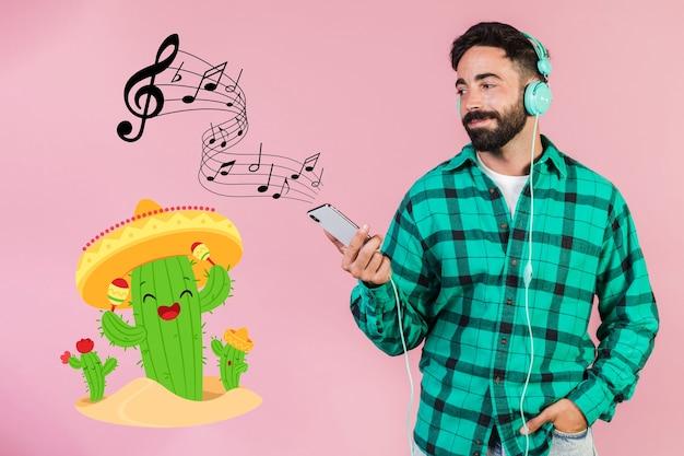 Casual jovem ouvindo música no celular ao lado de sinais de mão desenhada
