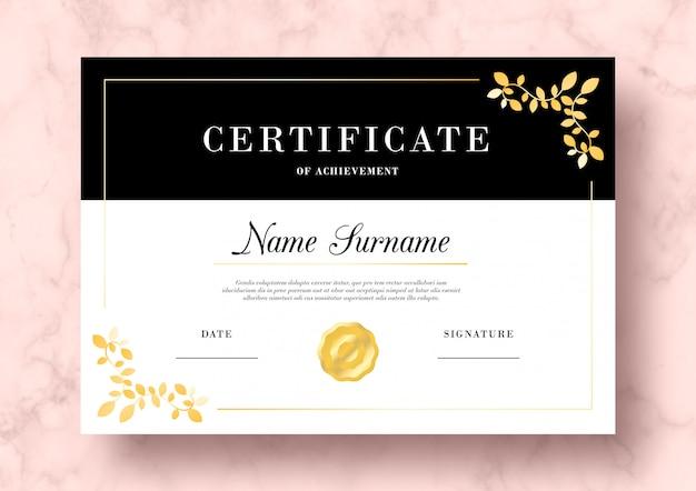 Certificado elegante de conquista com folhas douradas modelo psd