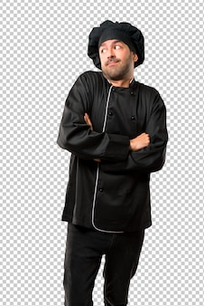 Chef man em uniforme preto fazendo sem importância e duvida gesto enquanto levanta os ombros