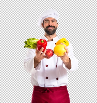 Chef segurando legumes
