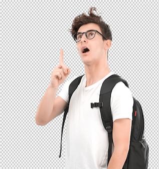 Chocado jovem estudante apontando para cima com a mão