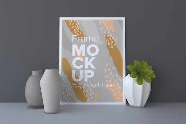 Close de uma moldura branca com vasos em uma maquete de moldura de fundo de parede cinza