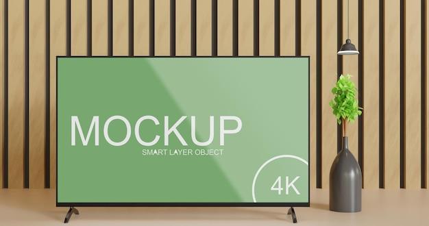 Close-up da tela de tv preta com vaso de planta