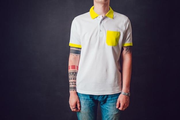 Close-up em young man using mockup t-shirt