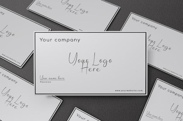 Close-up na maquete do cartão de visita com fundo de textura preta