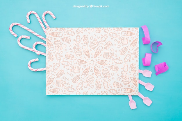 Composição de celebração com bastões de papel e doces