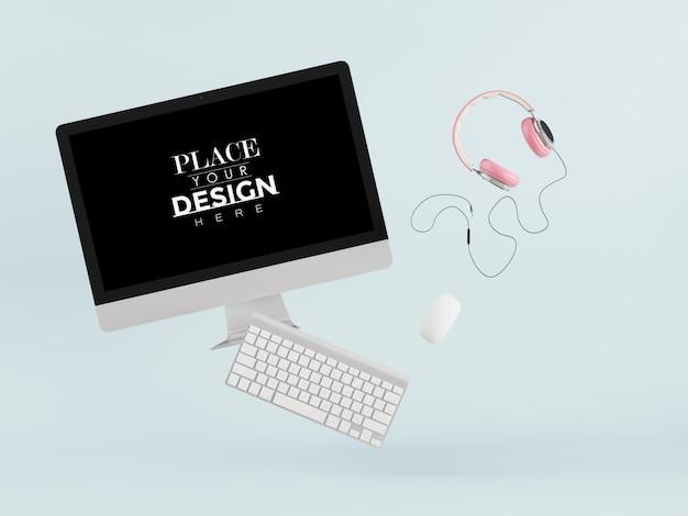 Computador com tela em branco com teclado e fones de ouvido