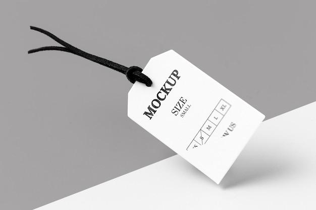 Conceito abstrato branco do mock-up do tamanho da roupa