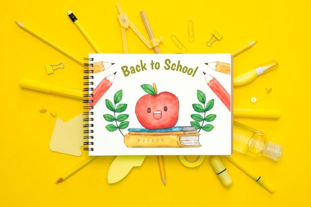 Conceito de escola vista superior com canetas