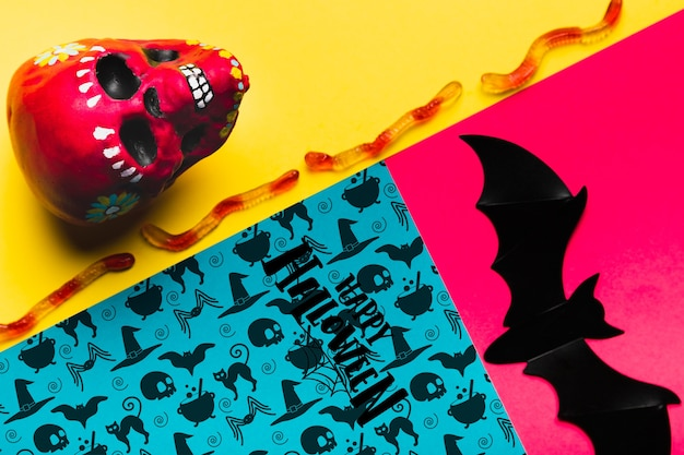 Conceito de halloween com caveira e morcego