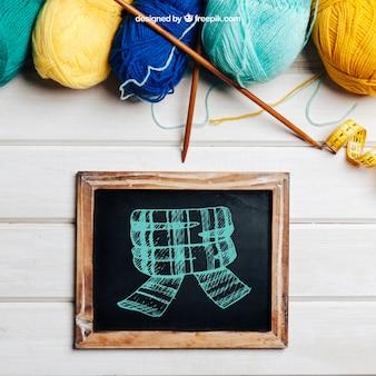 Conceito de tricô com ardósia e lã