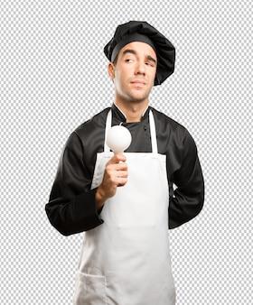 Conceito de um jovem chef tendo uma ideia
