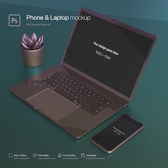 Configuração de telefone e laptop sobre uma maquete abstrata da área de trabalho