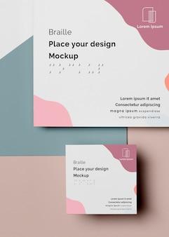 Configuração plana do design de cartão de visita em braille