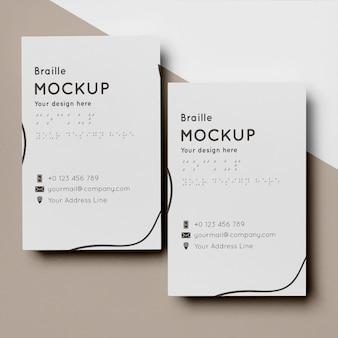 Configuração plana do design do cartão de visita com escrita em braille